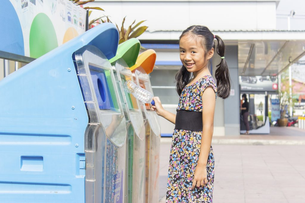 Girl at Recycling Bin